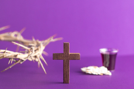 Symboles of Christianity and the Communion on a Purple Background