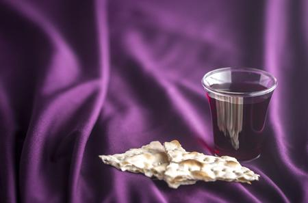 Christian Communion on a Purple Fabic Background Archivio Fotografico