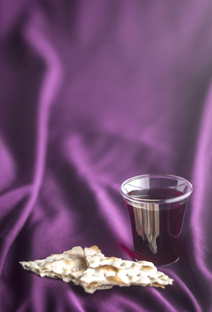 Christian Communion on a Purple Fabic Background Imagens