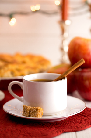 Hot Apple Cider with an Apple Pie and Cinnamon Stick