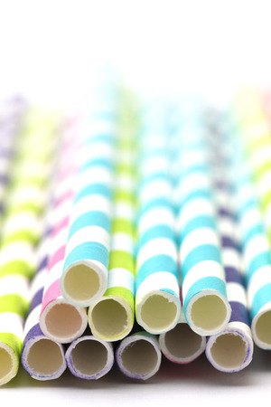Stripped Paper Straws on a White Background Stock Photo
