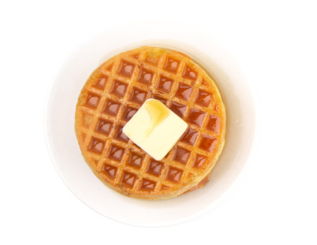 Round Waffles Ready for Breakfast on a White Background Imagens