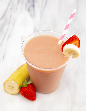 Strawberry and Banana Smoothie in a Disposable Plastic Cup