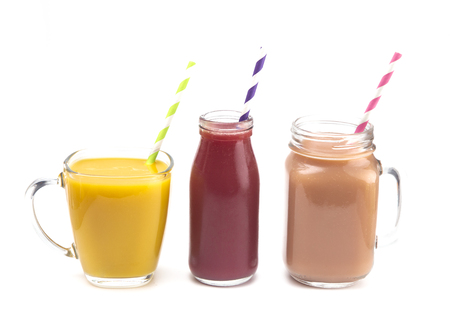 Three Fruit Smoothies in Various Cups with Paper Straws Stockfoto