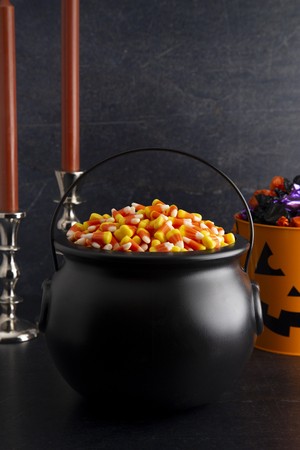 Black Cauldron For Witches FIlled with Candy Corn Stock Photo