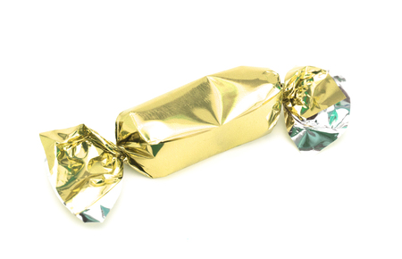 Gold Wrapped Candy on a White Background Stok Fotoğraf