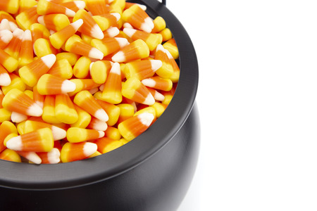 Black Cauldron For Witches FIlled with Candy Corn Stock fotó