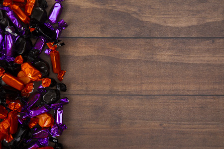 Halloween Candy Background on a Wooden Table