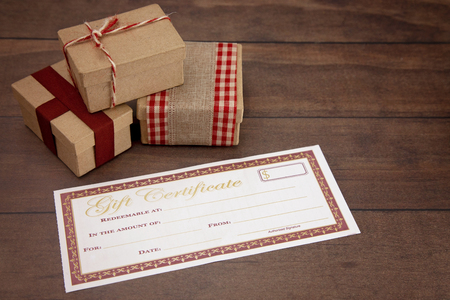 Blank Gift Voucher on a Wooden Table