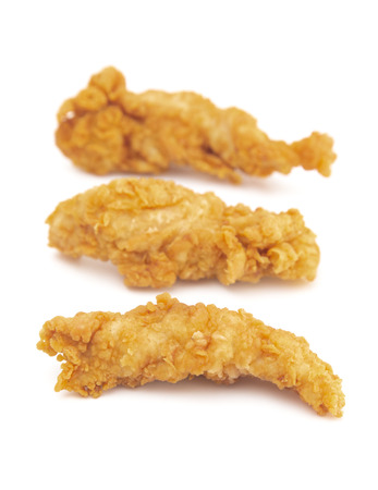 Golden Fried Chicken Fingers on a White Background