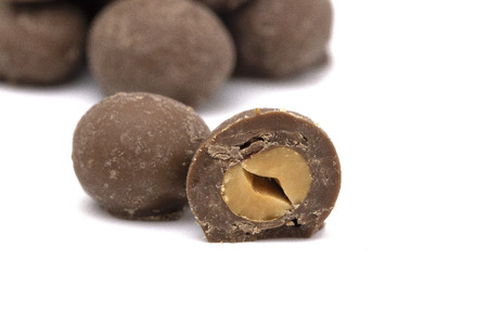 Milk Chocolate Covered Peanuts on a White Background