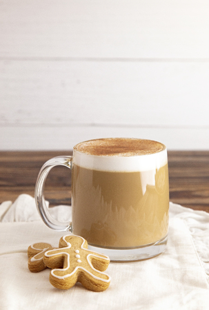 A Gingerbread Latte in a Clear Mug with Cookies on the Side