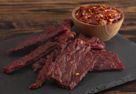 A Pile Hot and Spicy Beef Jerky with Red Pepper Flakes