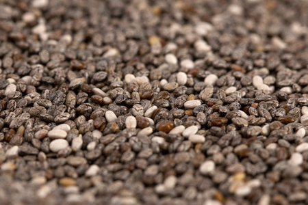 A Background of Organic Raw Chia Seeds Stock Photo