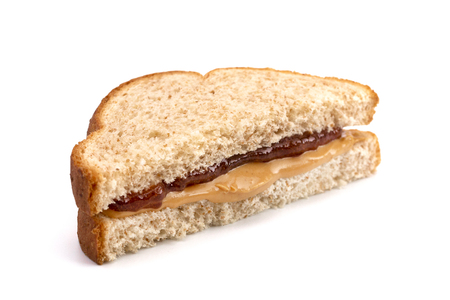 Classic Peanut Butter and Strawberry Jelly Sandwich on Wheat Bread 免版税图像