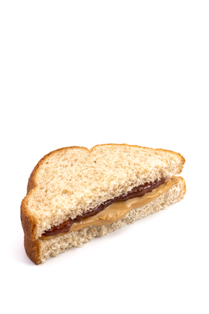 Classic Peanut Butter and Strawberry Jelly Sandwich on Wheat Bread 스톡 콘텐츠