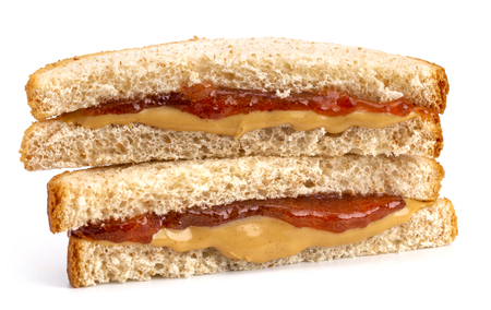 Classic Peanut Butter and Strawberry Jelly Sandwich on Wheat Bread Imagens