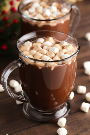 A Pair of Mugs Filled with Hot Chocolate and Marshmallows on a Wooden Table