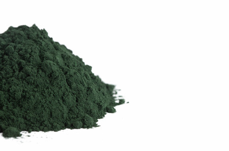 A Pile of Spirulina Powder on a White Background