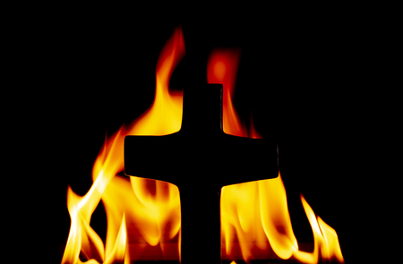 Cross with Fire in the Background Standard-Bild