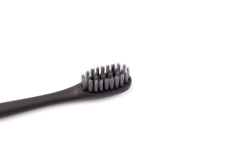 A Black Toothbrush without Toothpaste on a White Background
