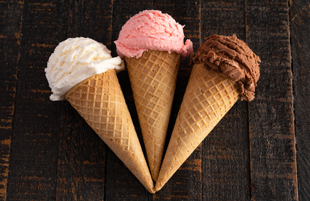 Three Classic Flavors of Ice Cream on a Wooden Table Stock Photo