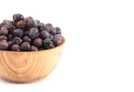 A Bowl Full of Dried Juniper Berries Archivio Fotografico