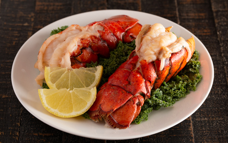 Two Broiled Lobster Tails on a Bed of Kale with Lemon Slices Stock fotó - 122562658