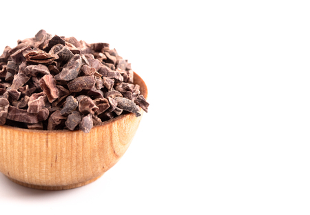 A Bowl of Chocolate Nibs Isolated on a White Background Reklamní fotografie - 122562752