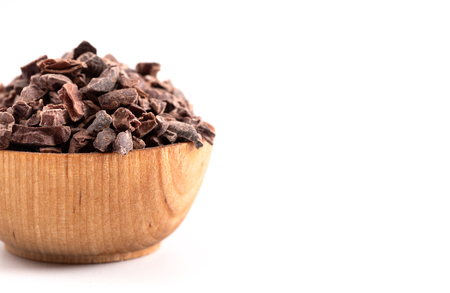 A Bowl of Chocolate Nibs Isolated on a White Background
