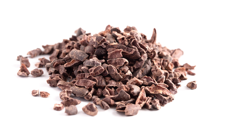 A Pile of Raw Chocolate Nibs on a White Background Foto de archivo - 122562808