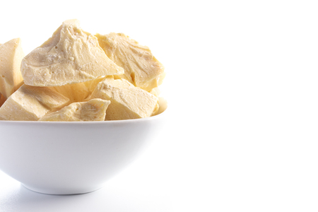 Chunks of Raw Organic Cocoa Butter Isolated on a White Background