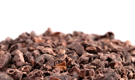 A Pile of Raw Chocolate Nibs on a White Background Foto de archivo - 122562955
