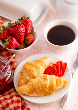 Table Set for Breakfast with Croissants Strawberries and Coffee