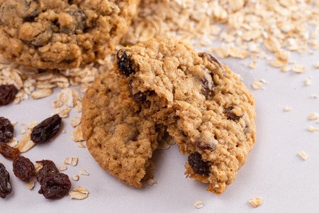 Cinnamon Raisin Oatmeal Cookies with Raw Ingredients on a Marble Counter Stock Photo