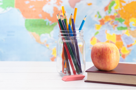 Back to School Background with School Supplies and a World Map in the Background 스톡 콘텐츠