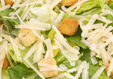 Background of Fresh Caesar Salad with Parmesan Cheese and Croutons