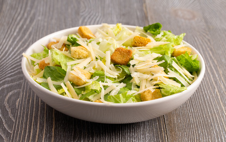 Fresh Caesar Salad on a Wooden Kitchen Table