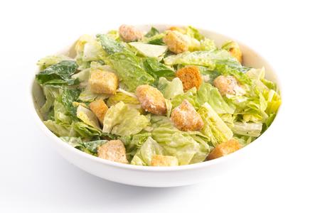 Fresh Caesar Salad Isolated on a White Background Banco de Imagens