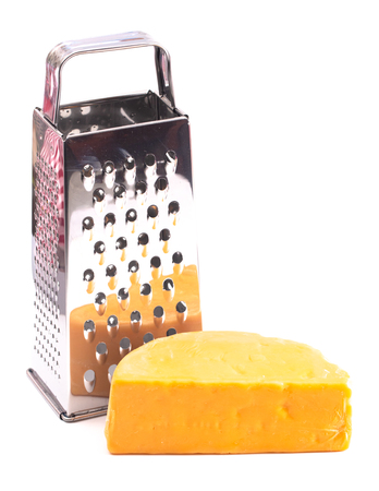 A Round of Cheddar Cheese Grated on a White Backgrouned Imagens
