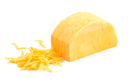 A Round of Cheddar Cheese Grated on a White Backgrouned Banque d'images