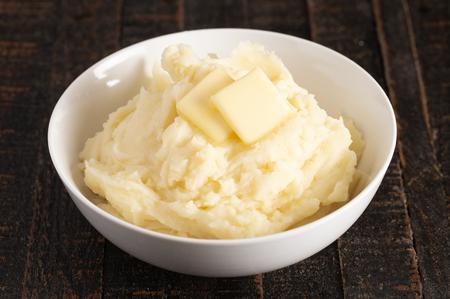 Homestyle Mashed Potatoes with Butter on a Wooden Table