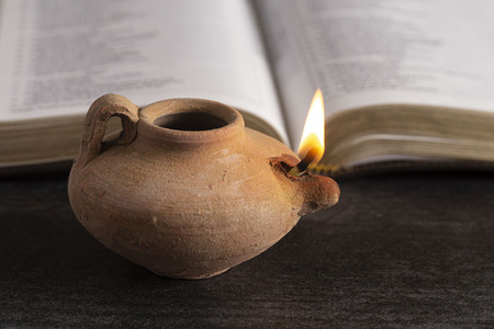 A Lit Ancient Oil Lamp with an Open Bible Thy Word is a Lamp Unto My Feet