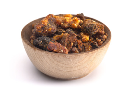 Sweet Myrrh Opoponax in a Bowl Isolated on a White Background
