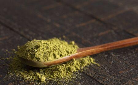 Spoon of Green Tea Matcha Powder on a Woodn Table