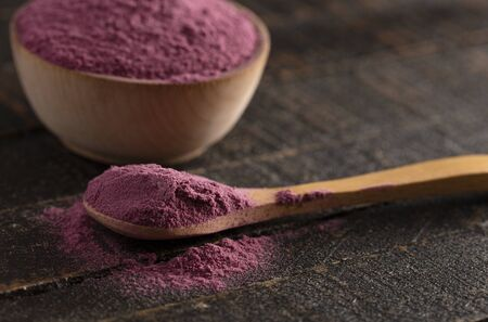 Bright Colored Acai Berry Powder Perfect for Adding to Recipes like Smoothies 写真素材