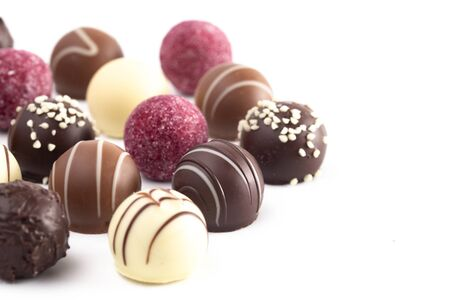 A Variety of Chocolate Truffles Isolated on a White Background Stock fotó