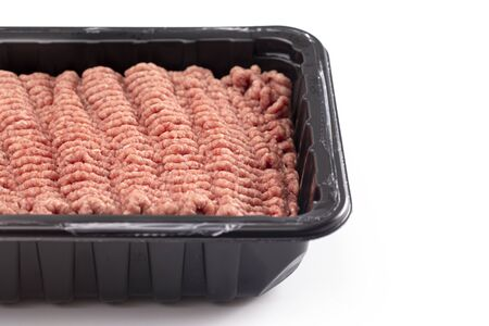 Raw Hamburger Meat in a Plastic Package Isolated on a White Background