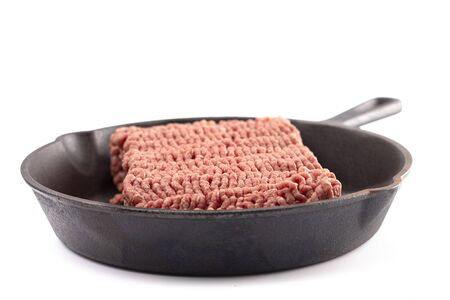 Raw Hamburger Meat in a Cast Iron Skillet