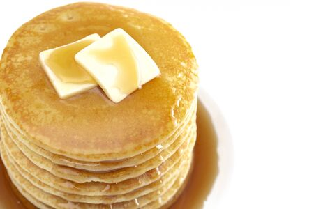 Stack of Freshly Made Buttermilk Pancakes with Syrup and Butter Isoalted on a White Background